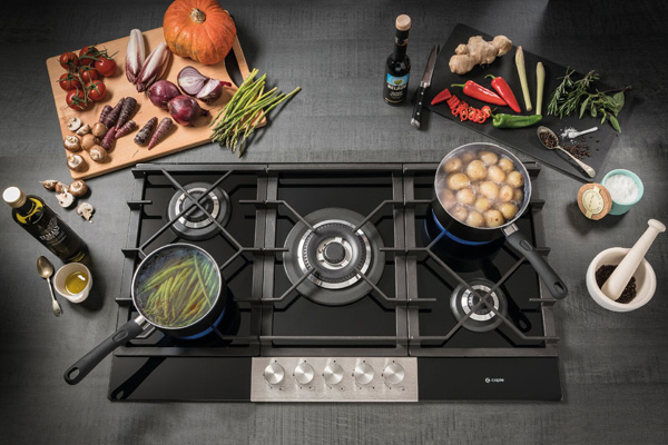 Extending its hob collection, Caple has introduced five burner gas-on-glass models which feature a stainless steel control panel. The C789C and C787G hobs measure 874mm and 700mm, respectively, but share the same features. This includes DirectHeat+ technology, where the flame is concentrated to heat the base of the pan, rather than losing heat around the outside, and auto-ignition. They boast a central 4.2kW triple ring burner, a 2.6kW rapid burner, two semi-rapid 1.75kW burners and a 1.0kW simmer burner. Completing the appliances, both gas-on-glass hobs boast cast iron pan supports 2